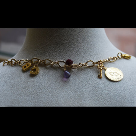 Charm Bracelet Design with Ruby, Amethyst and Gold from Specfic Skills Class