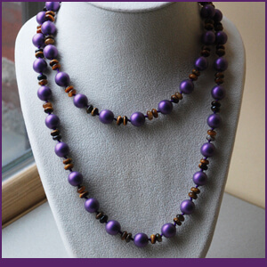 Knotted Necklace Design with Tigers Eye and Purple Pearls from Specific Skills Jewelry Class